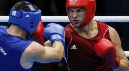 Казахстанский боксер-супертяж пробился в четвертьфинал Олимпиады