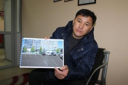 Владелец ночной автостоянки, которую жители соседнего дома считают незаконной, представил проект благоустройства парковки