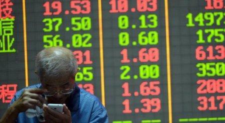 Власти Китая девальвировали юань на рекордные 1,9 процента