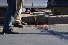 Украинские коммунальщики закатали в асфальт разводной мост в Николаеве