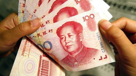 ЦБ Китая понизил курс юаня к минимуму за 4,5 года до 6,48 за доллар США