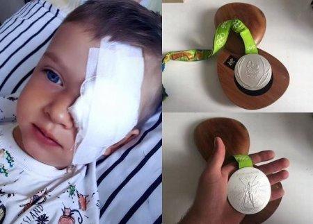 Призёр Олимпиады продал медаль ради спасения пятилетнего ребёнка от рака