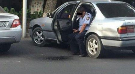 В ДВД установили личность полицейского, справившего нужду сидя в машине
